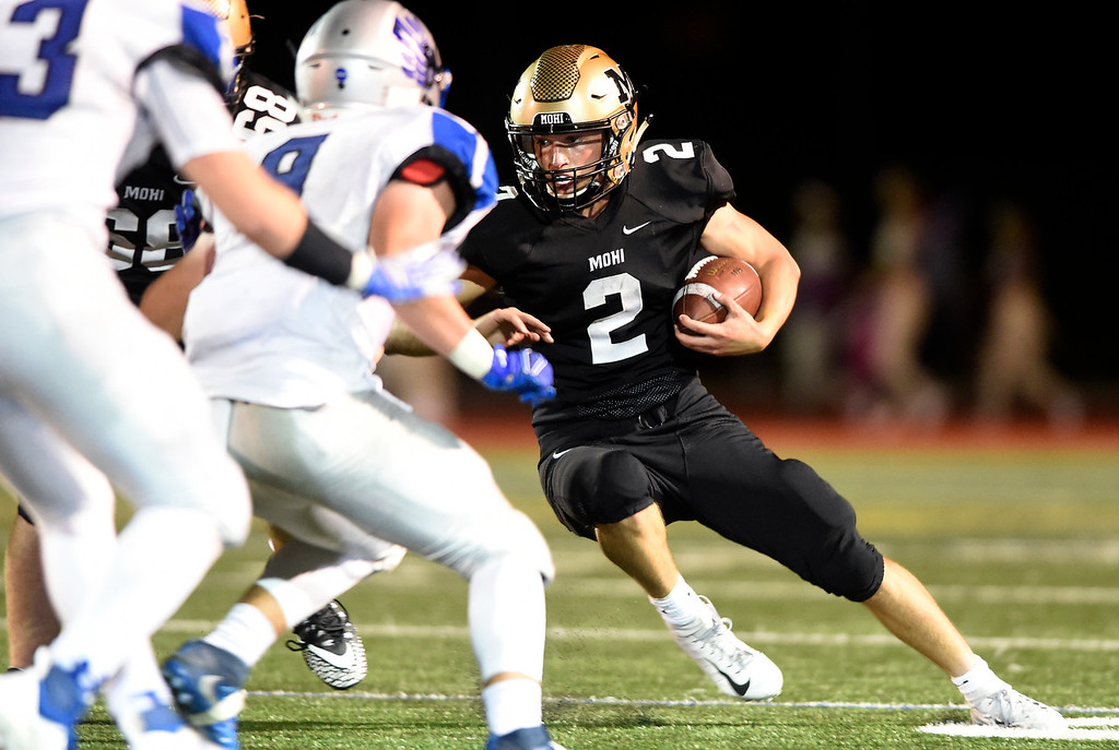 . LAFAYETTE, CO - SEPTEMBER 21, 2018: Monarch High School\'s Ricky Stimae runs the ball during a game against Broomfield on Friday at Centaurus High School in Lafayette. More photos: BoCoPreps.com (Photo by Jeremy Papasso/Staff Photographer)