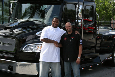 SAM AND RANDY STARKS SHAKING HANDS AFTER HIS NEW SPORT CHASSIS PURCHASE
