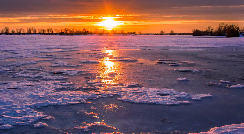 ~~ Frozen Sunset ~~<br /> <br /> Had the best time clicking this shot trying to balance myself on the frozen icy surface of Bountiful pond.