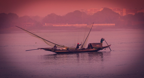 ~~ Fishing in morning~~  Location : Hoogli River, Kolkata, India.  Boatmen move in early morning to catch fishes.