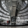 Berlin / Germany - December 15 2018: Visitors walk around the glass dome on top of the Reichstag Building, the German parliament, in central Berlin.