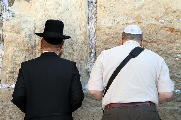 Jewish worshippers pray at the Western Wall (sometimes known as the Wailing Wall) in the Old City of Jerusalem