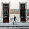 A woman walks past the side of the Lviv Coffee Mining Manufacture café, on Ruska Street in central Lviv, Ukraine