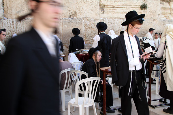 Jewish worshippers pray at the Western Wall (sometimes known as the Wailing Wall) in the Old City of Jerusalem on the West Bank.