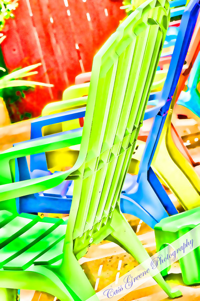 Adirondack chairs of many colors.