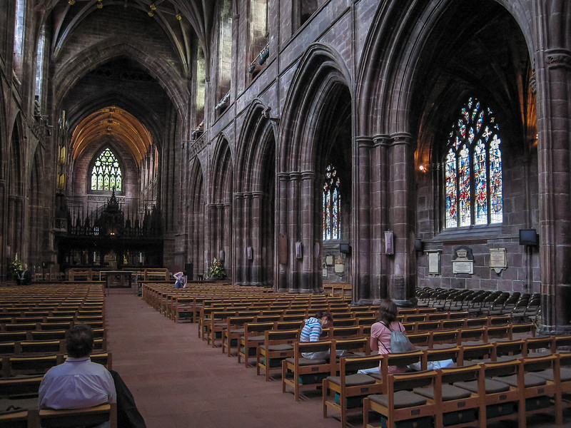Inside Chester Cathedral: the nave.  It is all very dark.