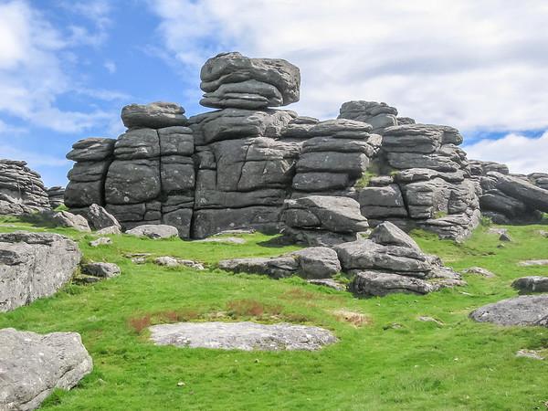 Dartmoor is a big pluton.  The tors are granite outcrops.