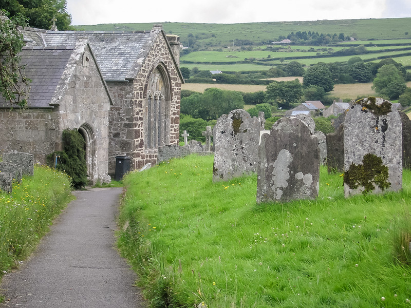 Approaching the parish church, St. Pancras, in Widecombe-in-the-Moor.  Nice view of the fields in the background.