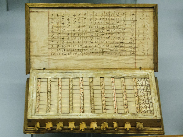 """Sunday, July 1.  We began today at the London Science Museum.  We focused on the computation section.  Napier's bones.  The label here says, """"John Napier invented this method to simplify multiplication using rods or """"bones"""" in 1617.""""  This set is believed to have been his."""