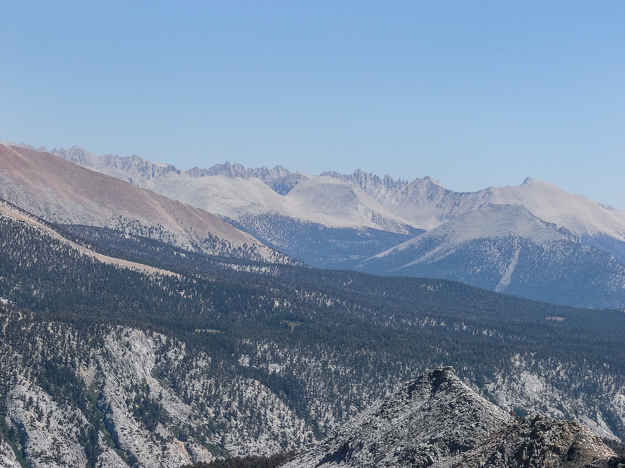 A zoom: Mt. Muir at the far left, Mt. Chamberlain (w/notch), Mt. Guyot.  Mt. Whitney is behind the Kaweah Peaks Ridge, farther left.