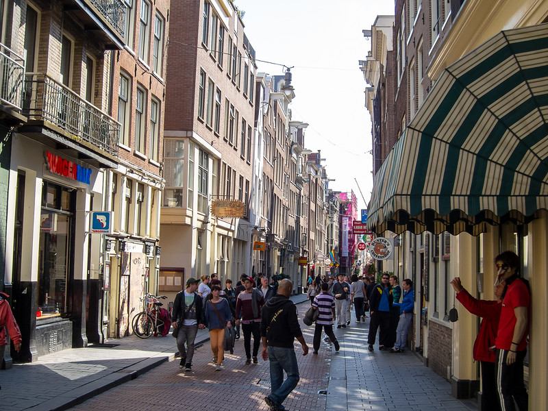 This narrow, very European alley, is the Warmoestraat ('Chard Street').  It's on the edge of the Red Light District.  One of the sex shops had a more racy window than any I'd seen at home in San Francisco.