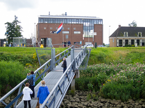 Arriving at Kinderdijk.  The plants on the shore are Impatiens glandulifera.  (Better picture later.)