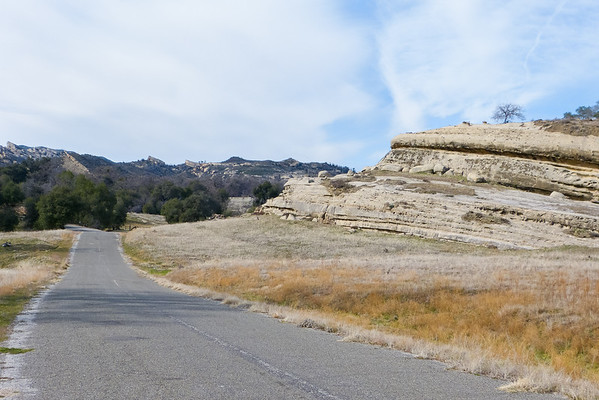 Down the road, I was taken by all the sandstone layering.  The gate to The Indians Ranch is visable ahead.