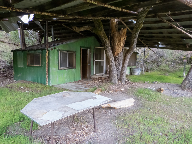 Under a metal roof was this two-room shack.