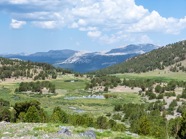 A view back to the meadow below Mono Pass and the Toulumne valley.  Lembert Dome is in the center.