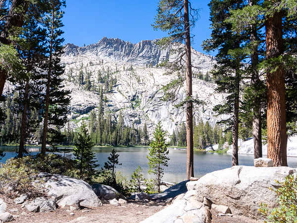 Thursday, July 3.  After an hour or so on the trail through rocky lodgepole forest -- not unlike yesterday's scenery -- I took a short detour to Lost Lake.  Prettier, I think than Ranger Lake.