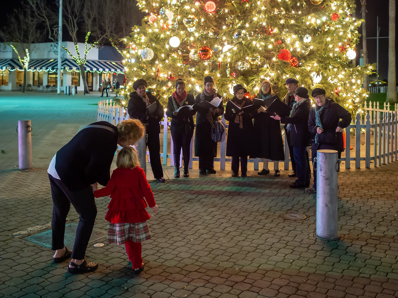 Jack London Square, December 8 - The caroling started by the big tree and collected the usual smattering of onlookers.