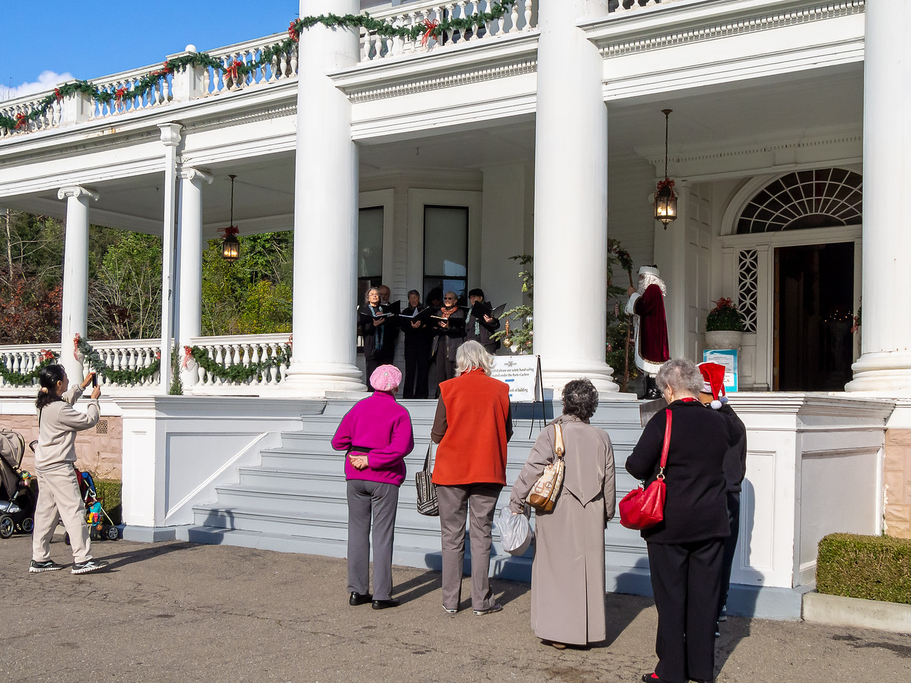Dunsmuir House, December 13.  TOSCA performed on the veranda: a fine place  for sound and for collecting passers-by.