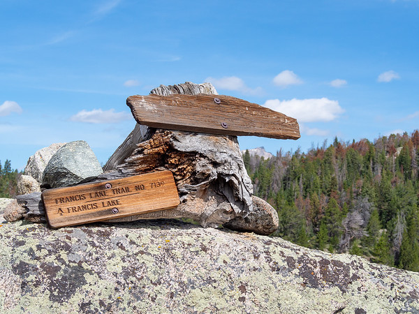 A rather unusual trail marker.  It's attached to an old stump and perched atop a boulder.