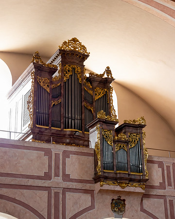 The organ is above the entry at the rear.