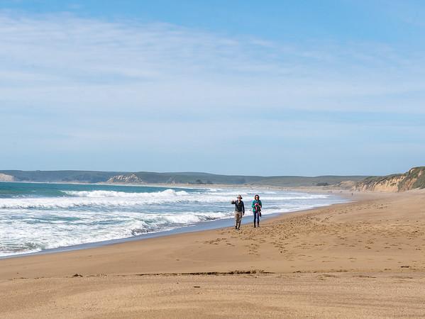 A pair of random walkers on the beach below Coast Camp.