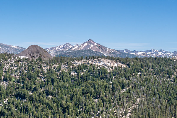 Over the top and part of the view south across the top of the Golden Creek basin and beyond.  Another lava cone ahead.  (The trail gets closer to this one.)  Sonora and Stanislaus Peak (higher) are the peaks is the  in the center.  A larger panorama is at the bottom of this gallery.