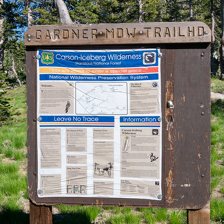 My trailhead is at the east side of the lower lake.  Kind of a low-budget sign with that printed plastic sheet.