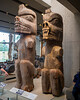 Kwakwa̱ka̱'wakw carvings, like those on these house posts, are bolder and have deep relief.  The Kwakwa̱ka̱'wakw are native to northern Vancouver Island and the mainland opposite.