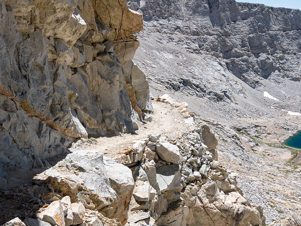 The section ahead, blasted into the cliff, is plenty exposed too, but is wider, doesn't switchback, and feels more comfortable.