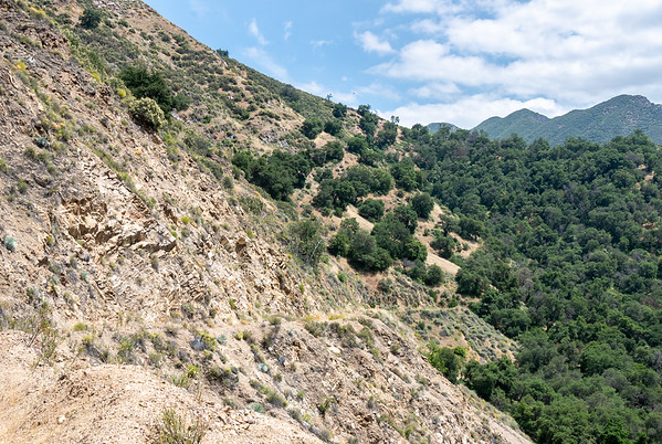 Hillside exposures by the road range from open rock to chaparral to oak savannah.