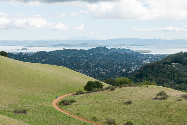 Heading down Bald Hill, with the sweep of the East Bay in the background.