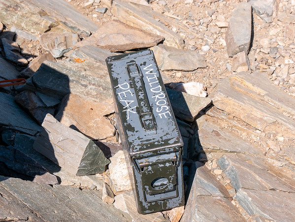 I didn't expect to find a summit register here -- this is a 4 mile / 2000' wooded walk-up, not a heavy-duty climb -- but here it is, in its WWII ammo box.