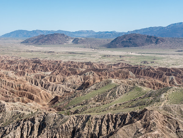 Looking south and a little east.  The badlands, Big Wash, the two buttes of the Borrego Mountains, and, in the distance, the Pinyon Mountains.  My second stop today, The Slot, is just behind the west (right) butter of the Borrego Mts.  All the green amazes me.