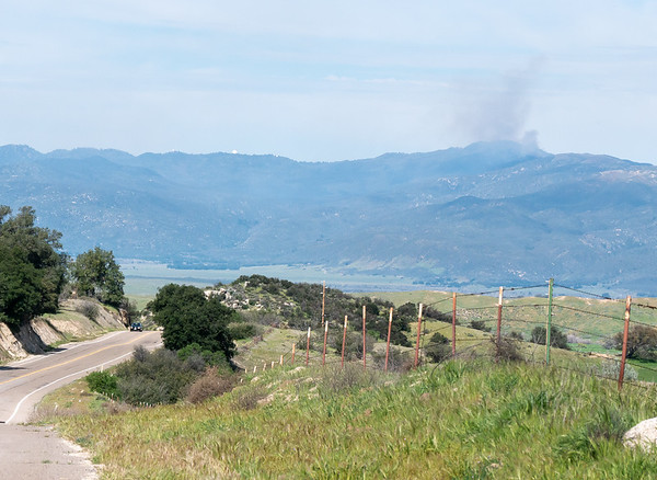 In the other direction, a view down to Valle de San Jose and up to Mt. Palomar.  From the web, I gather the fire at the right was a prescribed burn.