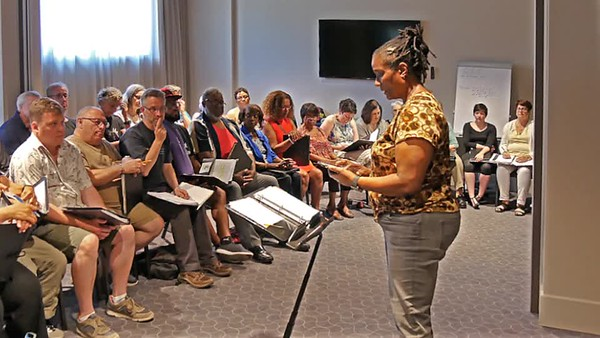 Sunday, June 24.  The chorus assembled this morning in one of the hotel conference rooms for a one hour rehearsal.  After aligning the group, Lynne began with this.  Not knowing what was coming, I picked up about 30 seconds in.   Not much to see, but do listen.  (1:26 video -- Click to play.)