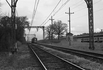 2018.008.CNSM.I.083--bruce meyer 35mm neg--CNS&M--electric interurban southbound Electroliner departing passing C&NW 400 train--Lake Bluff IL--1962 1000