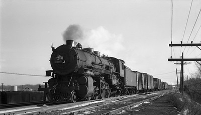 2018.008.CNW.S.0056--bruce meyer 116 neg--C&NW--steam locomotive 2-8-2 J 2460 on freight train action--Milwaukee WI--1950 1130
