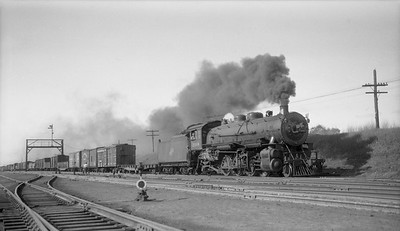 2018.008.CNW.S.0061--bruce meyer 116 neg--C&NW--steam locomotive 2-8-2 J 2348 on freight train action--Butler WI--1940 0524