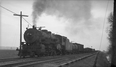 2018.008.CNW.S.0063--bruce meyer 116 neg--C&NW--steam locomotive 2-8-2 J-S 2379 on 80-car freight train on MP action--Bixby IL--1943 0324