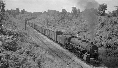 2018.008.CNW.S.0064--bruce meyer 116 neg--C&NW--steam locomotive 2-8-2 J-S 2511 on freight train action--near Radnor IL--1943 0917