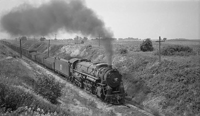 2018.008.CNW.S.0062--bruce meyer 116 neg--C&NW--steam locomotive 2-8-4 J-4 2803 on freight train action--north of Green valley IL--1941 0619