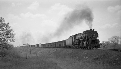 2018.008.CNW.S.0065--bruce meyer 116 neg--C&NW--steam locomotive 2-8-4 J-4 2801 on freight train action--near Dunlap IL--1943 1030