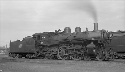 2018.008.CNW.S.0059--bruce meyer 116 neg--C&NW--steam locomotive 4-4-2 D 395--Chicago IL--1954 0912
