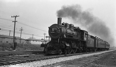 2018.008.CNW.S.0060--bruce meyer 116 neg--C&NW--steam locomotive 4-4-2 D 1450 on 2-car local passenger train action--near Highland Park IL--1941 0503