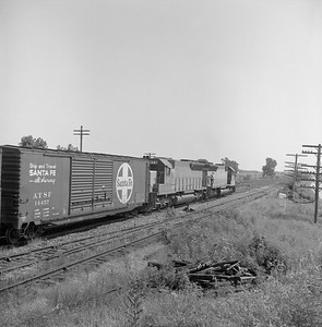 2018.008.CNW.FD.113--bruce meyer 120 neg--C&NW--EMD diesel locomotive 903 and 973 on eastbound freight train at coal chute--Nelson IL--1969 0730