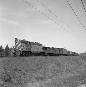 2018.008.CNW.FD.013--bruce meyer 120 neg--C&NW--EMD diesel locomotive 1577 on local freight train with caboose--between Eua Claire and Madison WI--1957 0603