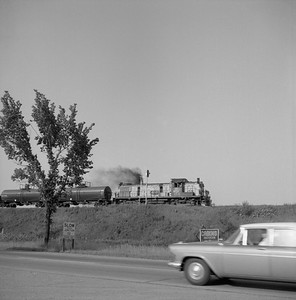 2018.008.CNW.FD.014--bruce meyer 120 neg--CStPM&O--ALCO diesel locomotive 164 on southbound freight train action--between Milwaukee and Chicago IL--1958 0628