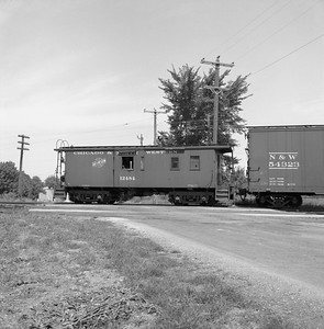 2018.008.CNW.FD.041--bruce meyer 120 neg--C&NW--wooden caboose on hind end of local freight train--west of Palatine IL--1958 0809
