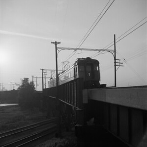 2018.008.CSSSB.I.011--bruce meyer 120 neg--CSS&SB--electric interurban westbound passenger train crossing bridge at 130th and Torrence--Chicago IL--1958 0623