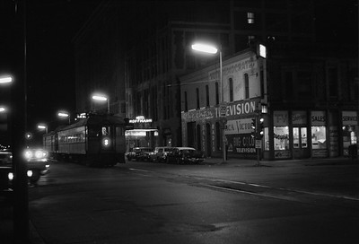 2018.008.CSSSB.I.099--bruce meyer 35mm neg--CSS&SB--electric interurban 104 and baggage 503 at LaSalle Street downtown station at night--South Bend IN--1962 1100
